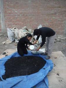 Preparing biochar in Peru